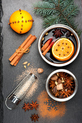 Christmas mulled wine with spices on chalkboard