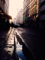 Tower Eiffel reflection on Paris street after the rain