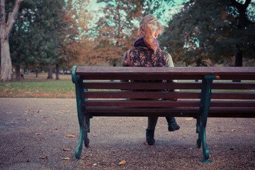 Rear view of woman on park bench