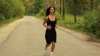 Young woman running in park.