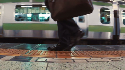 Business men board subway car in slow motion