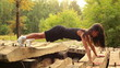 Young fitness woman doing push-ups.