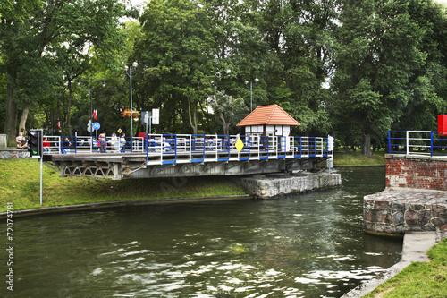 Leinwanddruck Bild Swing bridge in Gizicko. Poland