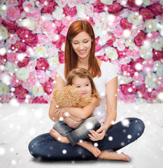 happy mother with little girl and teddy bear