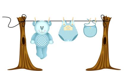 Baby boys clothing with teddy bear on clothesline