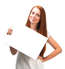 Beautiful red-haired girl holding a board isolated on white back