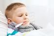 Leinwanddruck Bild - ill boy with flu at home