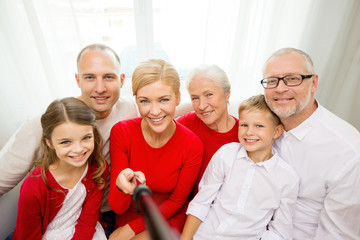 smiling family taking selfie at home
