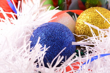 blue and yellow Christmas balls close up