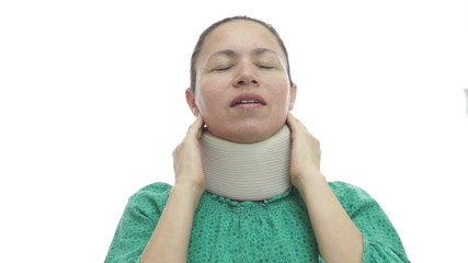 Woman With Neck Brace In Pain