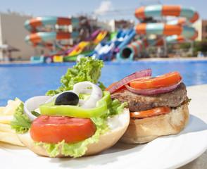 Closeup of beef burger with salad
