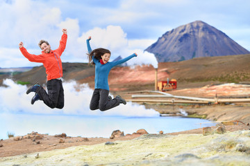 Iceland travel people jumping of joy in nature