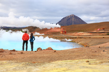 Iceland travel people by geothermal power plant