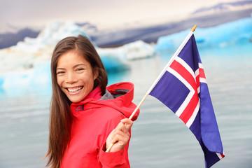 Icelandic flag - girl holding Iceland flag at glacier