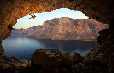 Male rock climber on a cliff in a cave at Kalymnos, Greece