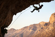 Male rock climber on overhanging cliff at Kalymnos, Greece