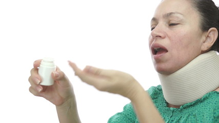 Woman With Neck Brace Taking Pills
