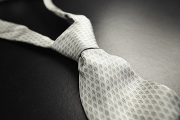 Elegant gray tie on a black