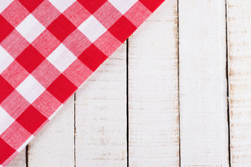 Kitchen towel on wooden table.