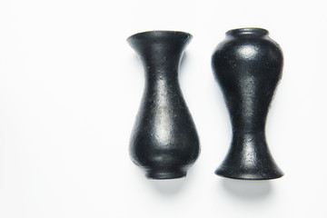 Two vases on a white background, one up side down