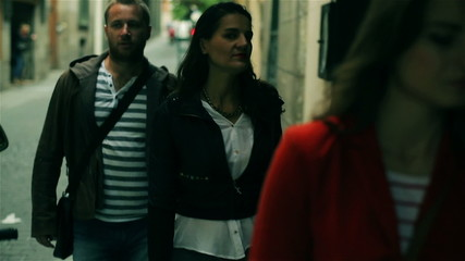 Friends walking on the street, steadycam shot