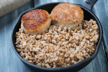 Buckwheat with meat cutlets, close-up, horizontal shot