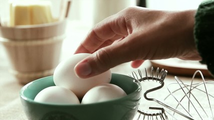 White eggs being picked up, Slow Motion