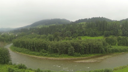 Lateral Flight over   mountain river with  house . Aerial