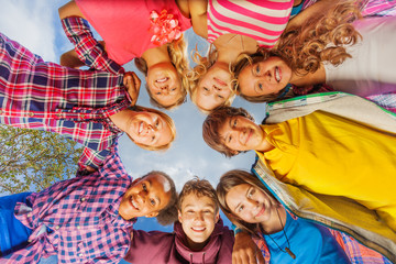 Below view of children standing in circle form