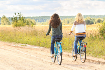 Two girls enjoying nature during bike trip