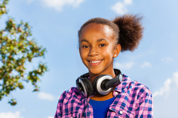 Beautiful portrait of African girl with headphones
