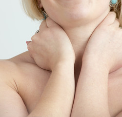 Woman's hands on her neck