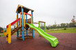 Slide on an empty playground - 72090707