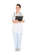 Happy Female Doctor Standing Against White Background