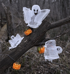 Ghosts and pumpkins in the forest