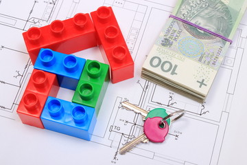 House of colorful building blocks, keys and banknotes