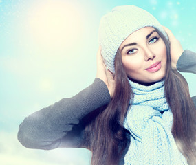 Beauty winter girl wearing hat and scarf