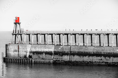 Scenic view of Whitby Pier in sunny day in black and white - 72092727