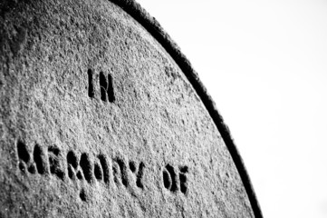 Closeup on Tomb stone with inscription In Memory Of