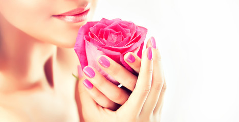Girl keeps a gentle flower , manicure and Spa