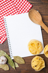 blank paper with pasta, pepper and spices