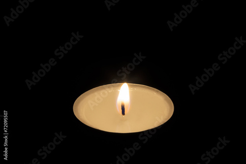 canvas print picture Single Tea Candle on Black