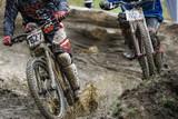 Mountainbikers splashing through mud
