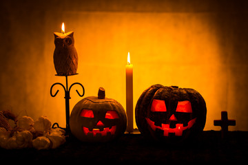 two halloween pumpkins with candles