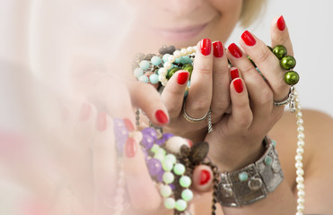 Bouquet of red nails and jewelry