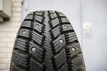 Studded winter tire close up