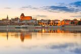 Torun old town reflected in Vistula river at sunset, Poland - Fine Art prints