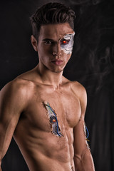 Bare Muscled Man with Body Art