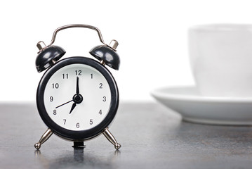 Alarm clock with cup of coffee