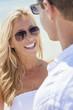 Man Woman Couple In Sunglasses on Beach